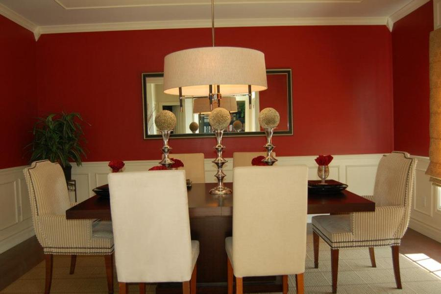 In this formal dining room, set the table and added a center piece ...
